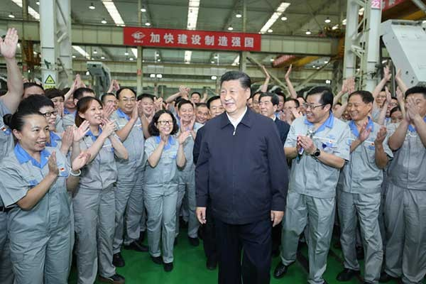 跟着党的脚步走 习近平:一定要把我国制造业搞上去。